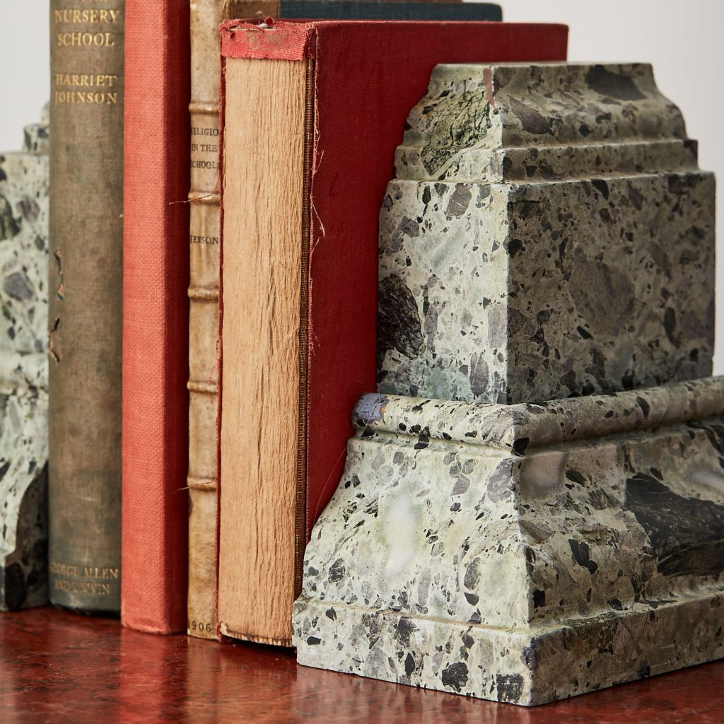 Green verde antico marble bookends with books