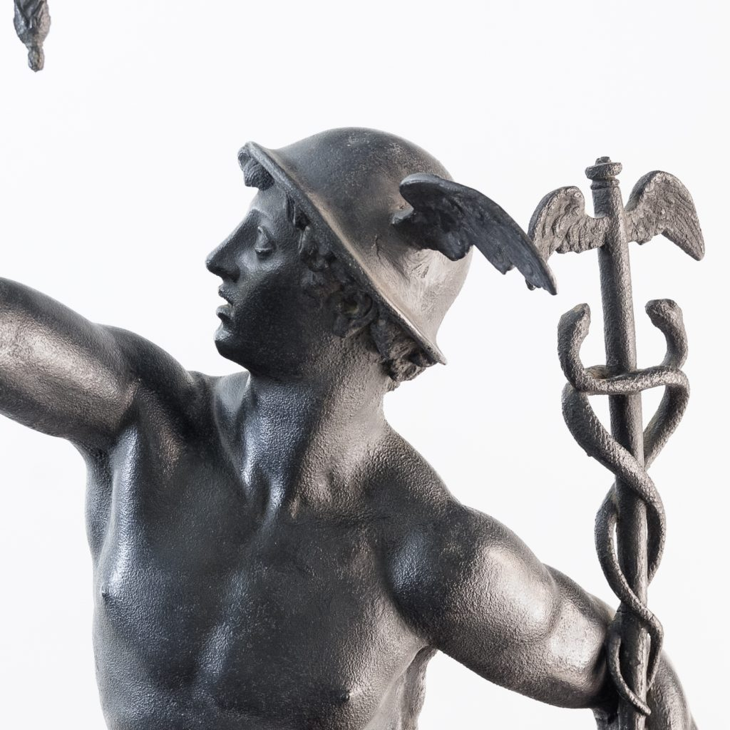 left hand clasping a Caduceus
