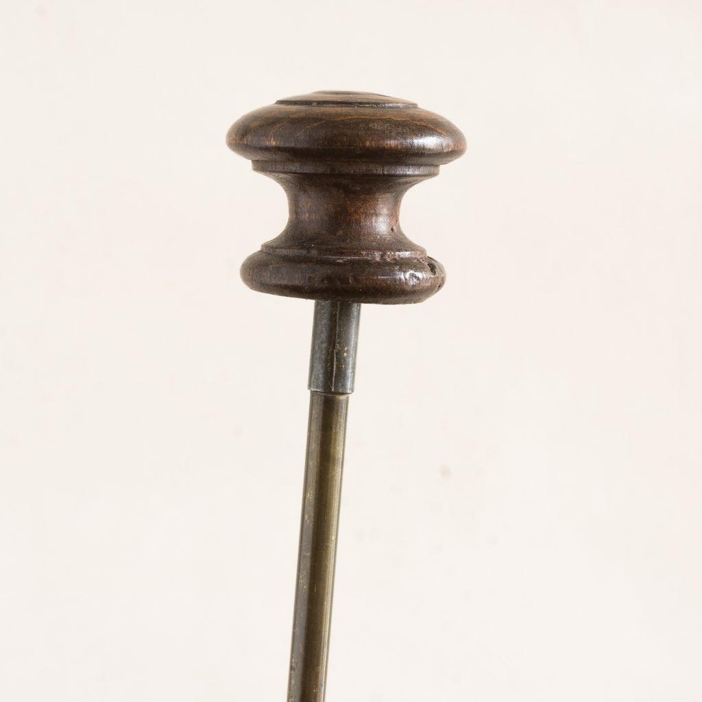 turned timber knob on brass upright