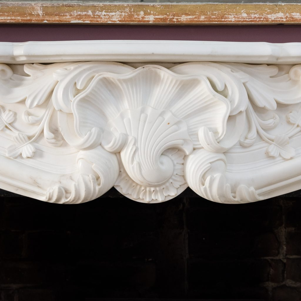 frieze centred by stylised scallop shell with an acanthus crest flanked by foliage