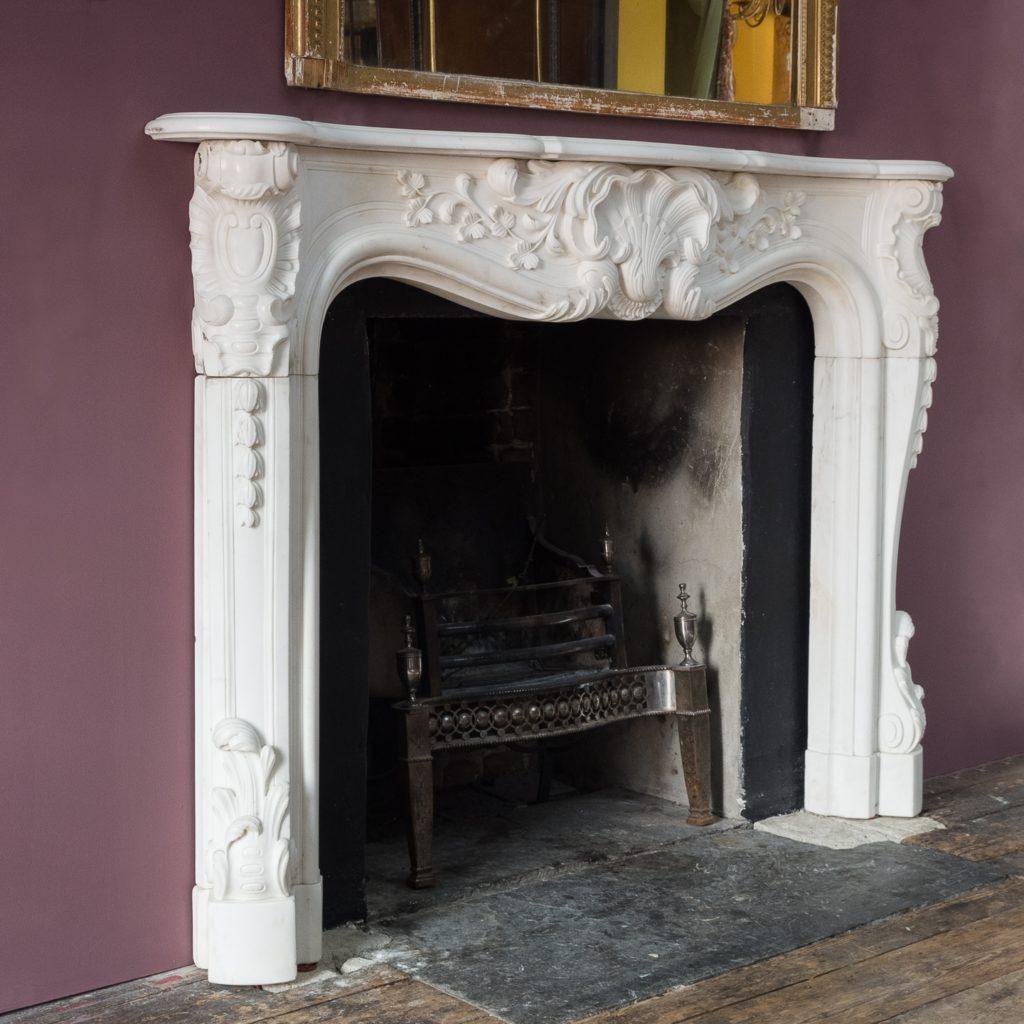 Early nineteenth century English Rococo Statuary marble chimneypiece,