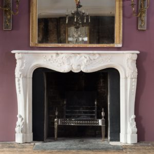 Early nineteenth century English Rococo Statuary marble chimneypiece,