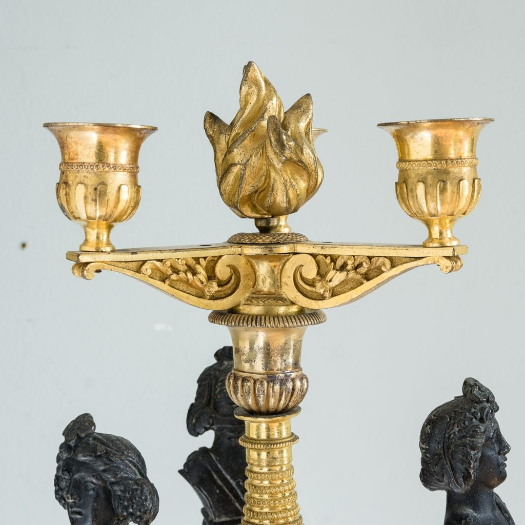 nozzles supported by architectural brackets with flaming urn to the centre