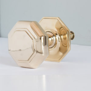 Large octagonal brass centre door pull,