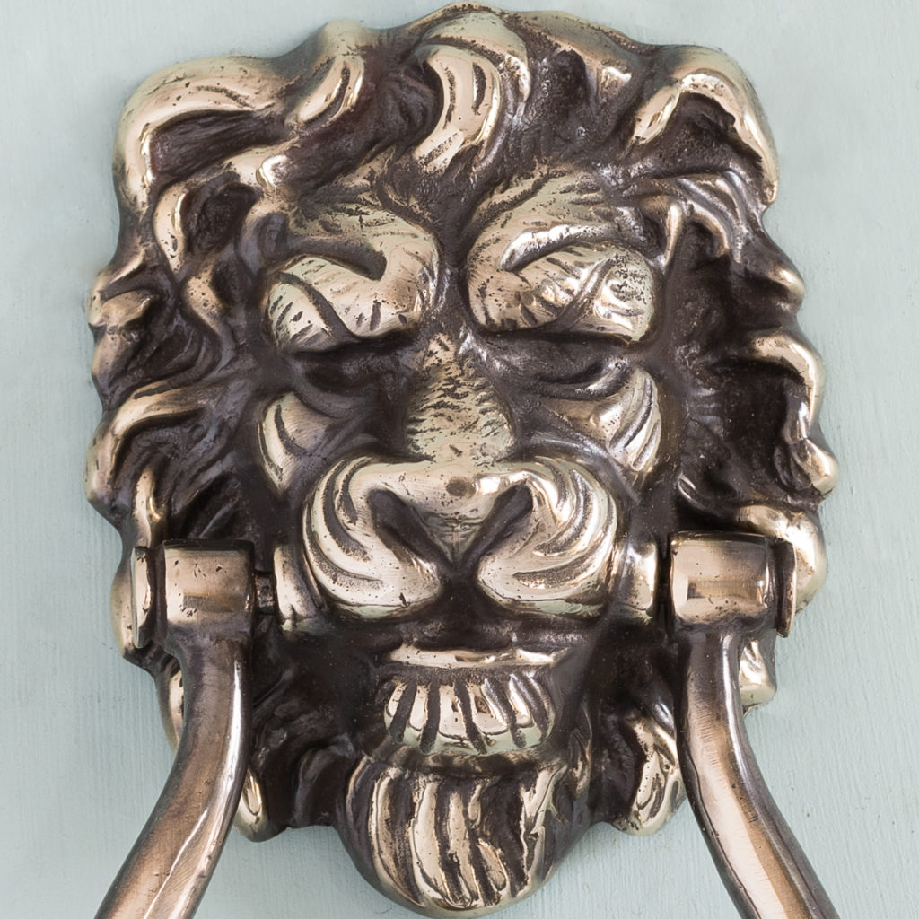 Brass lion's mask door knocker