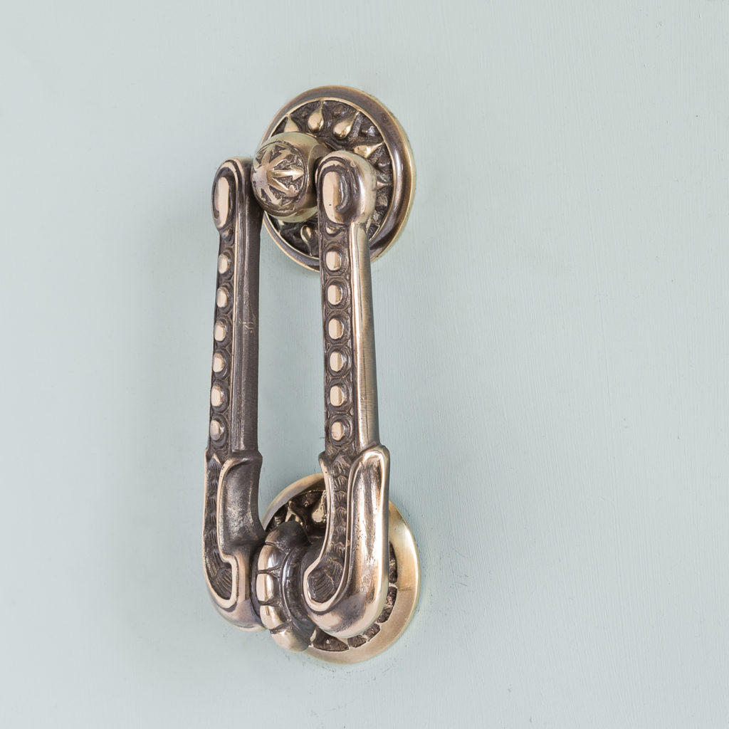 Nineteenth century style brass door knocker,