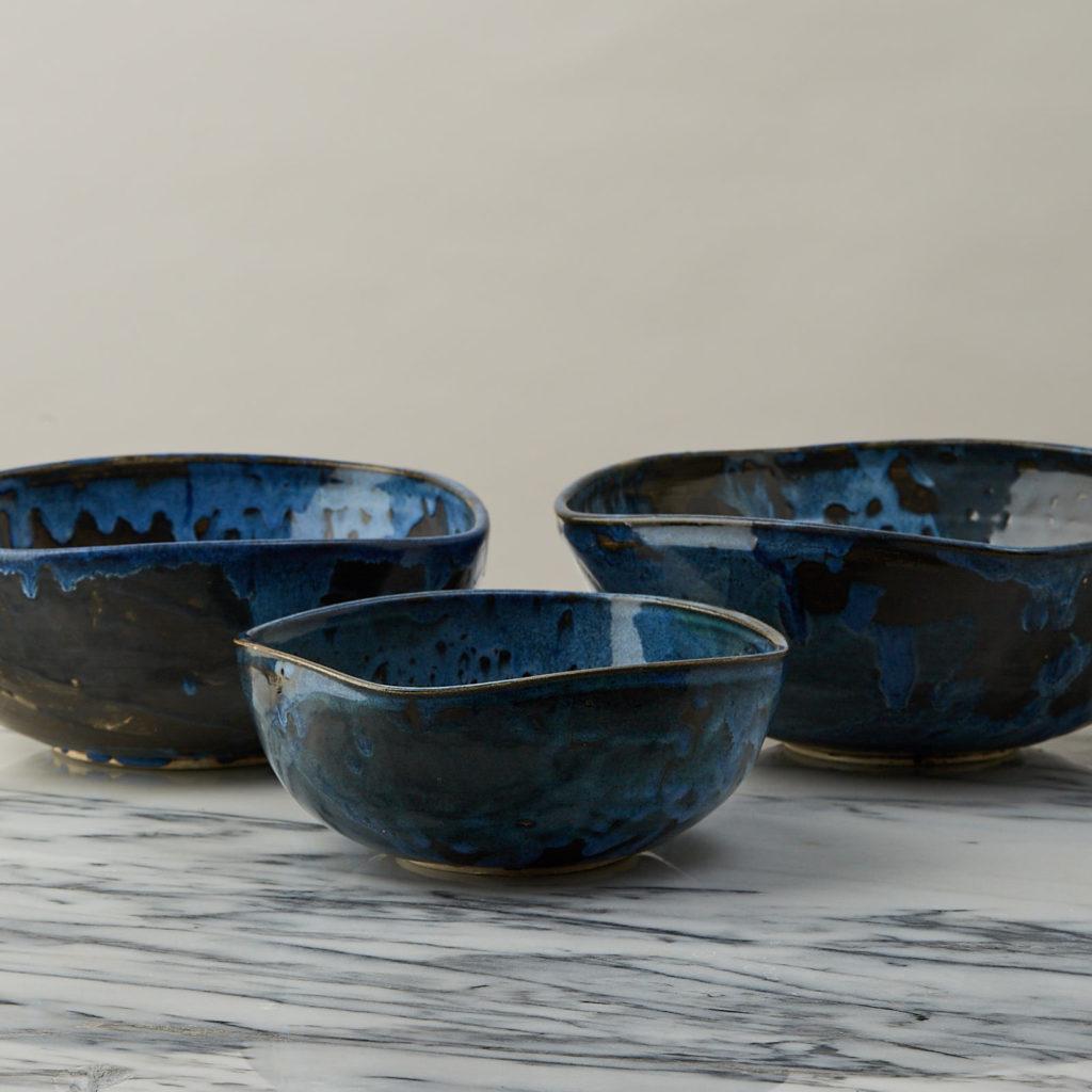 A nesting set of ceramic bowls,-127349