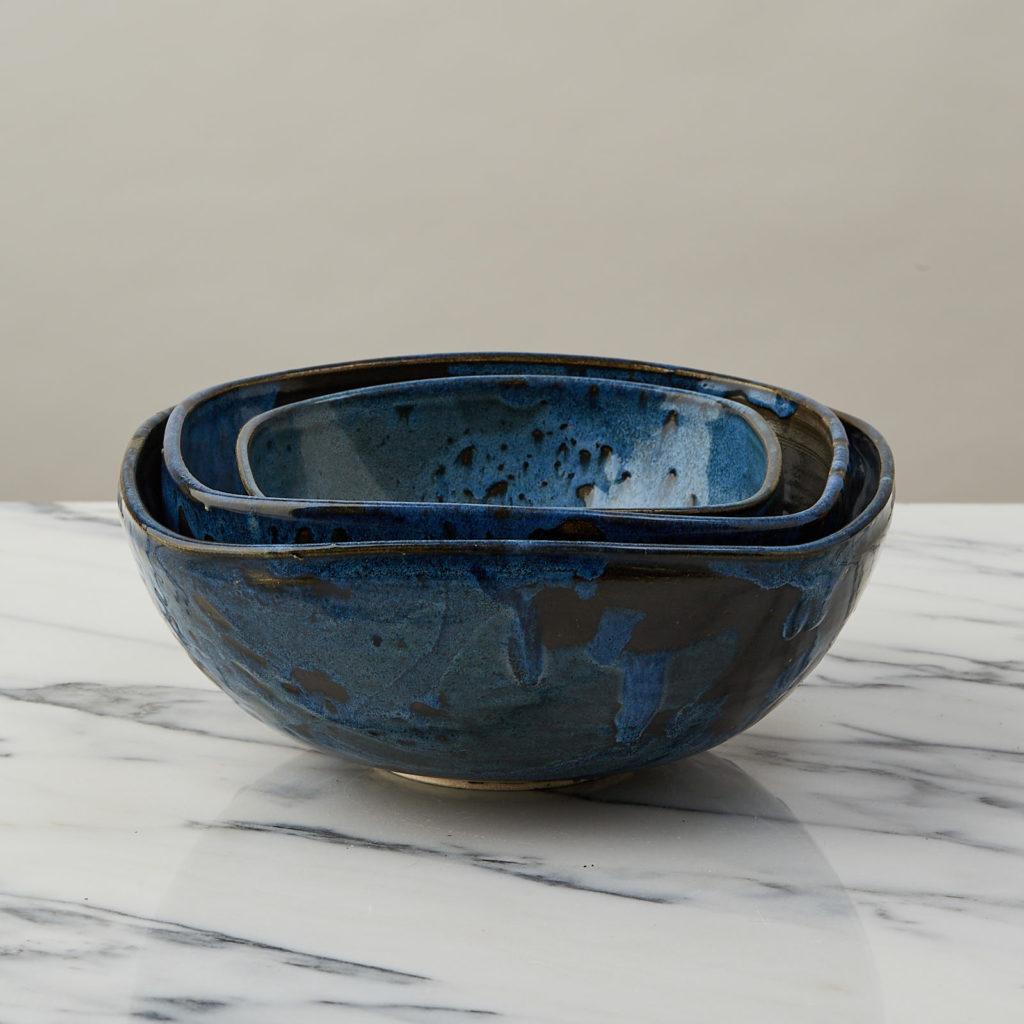 A nesting set of ceramic bowls,-0