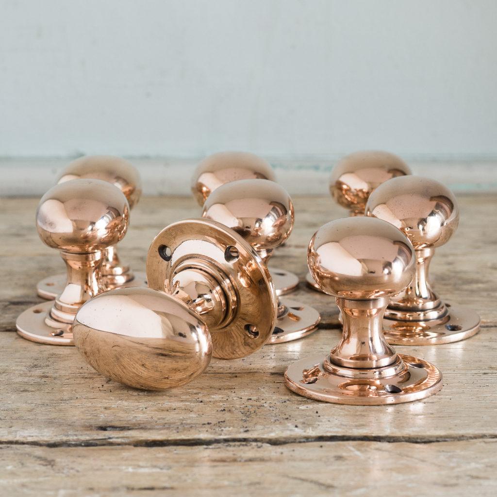 Large early twentieth century oval rose brass door knobs,