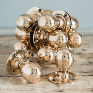 'KAYE' of Leeds rose brass door knobs,