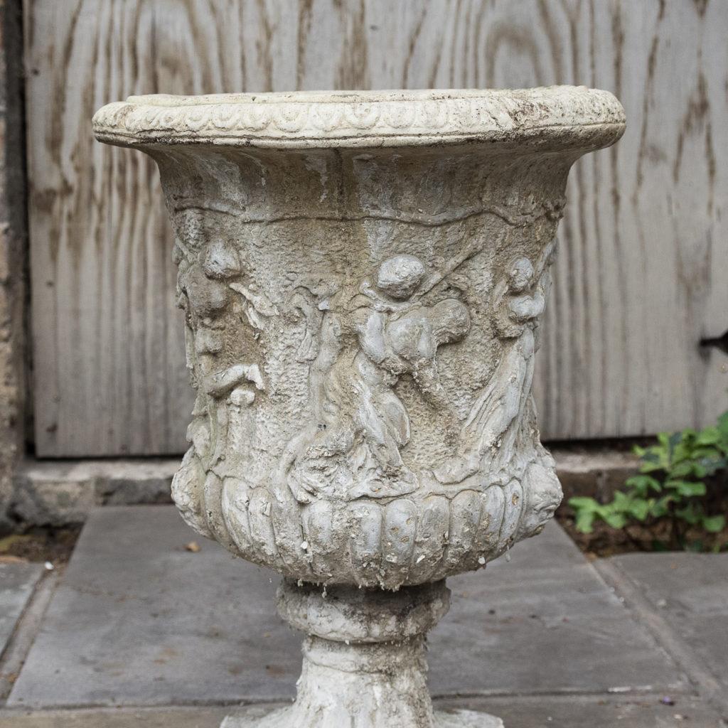 Pair of reconstituted stone Medici urns,