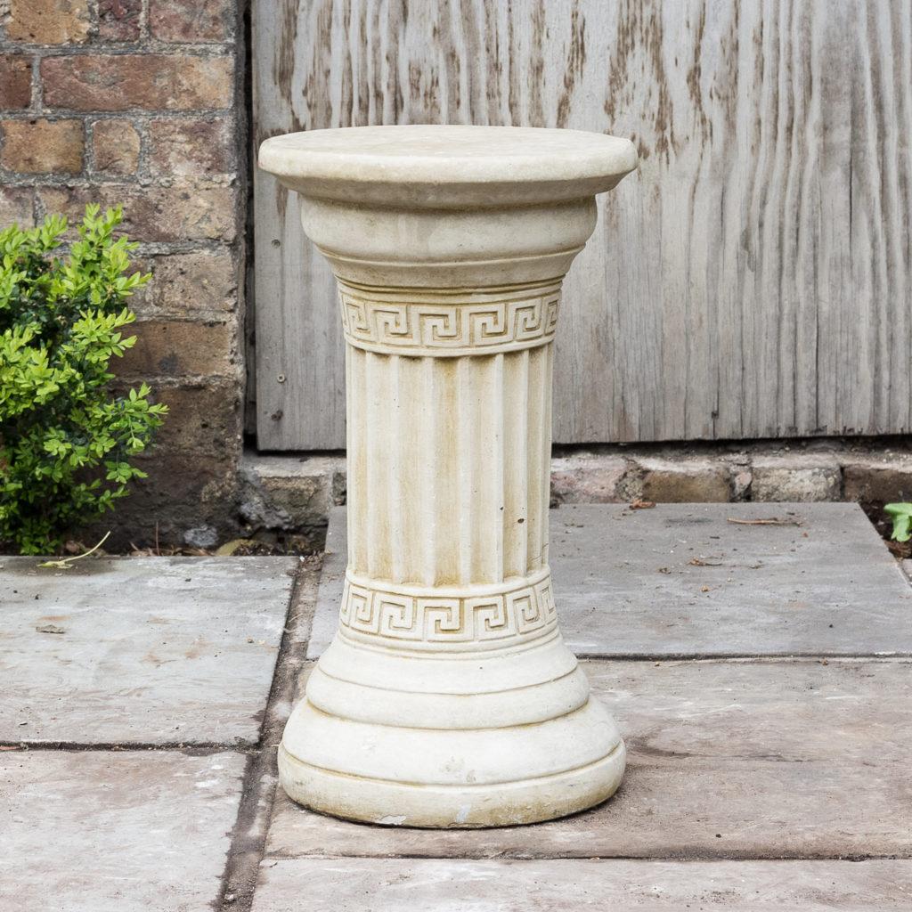 Fluted cast stone pedestal,