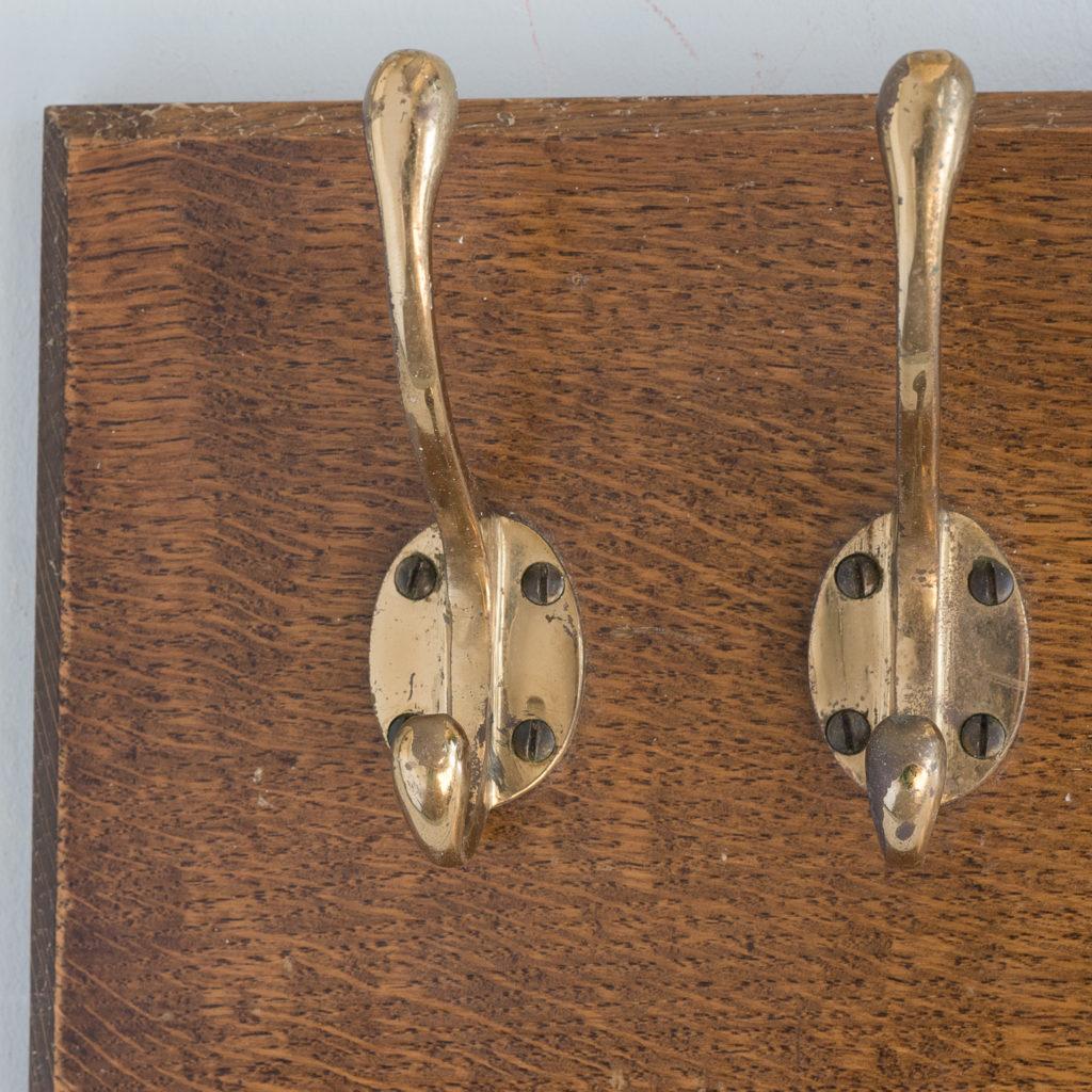 Set of four mounted brass coat hooks,-127334