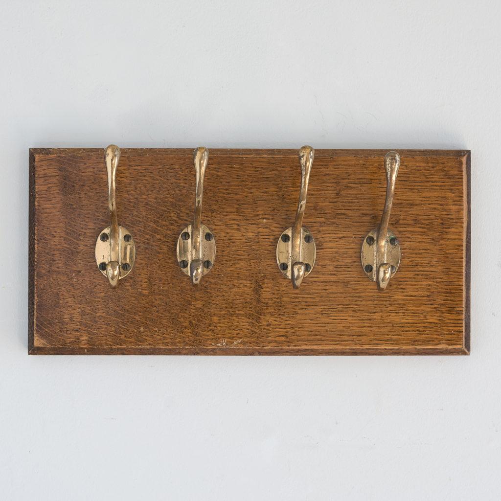 Set of 4 mounted brass coat hooks