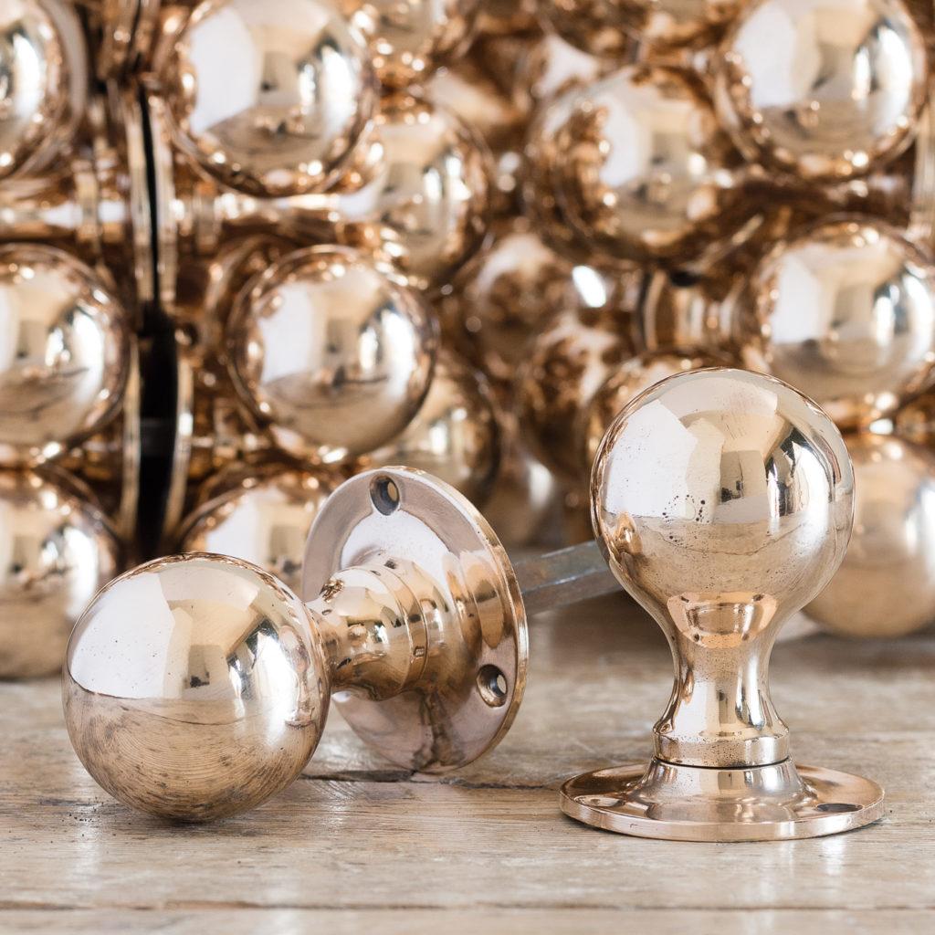 Large run of antique bronze spherical door knobs,