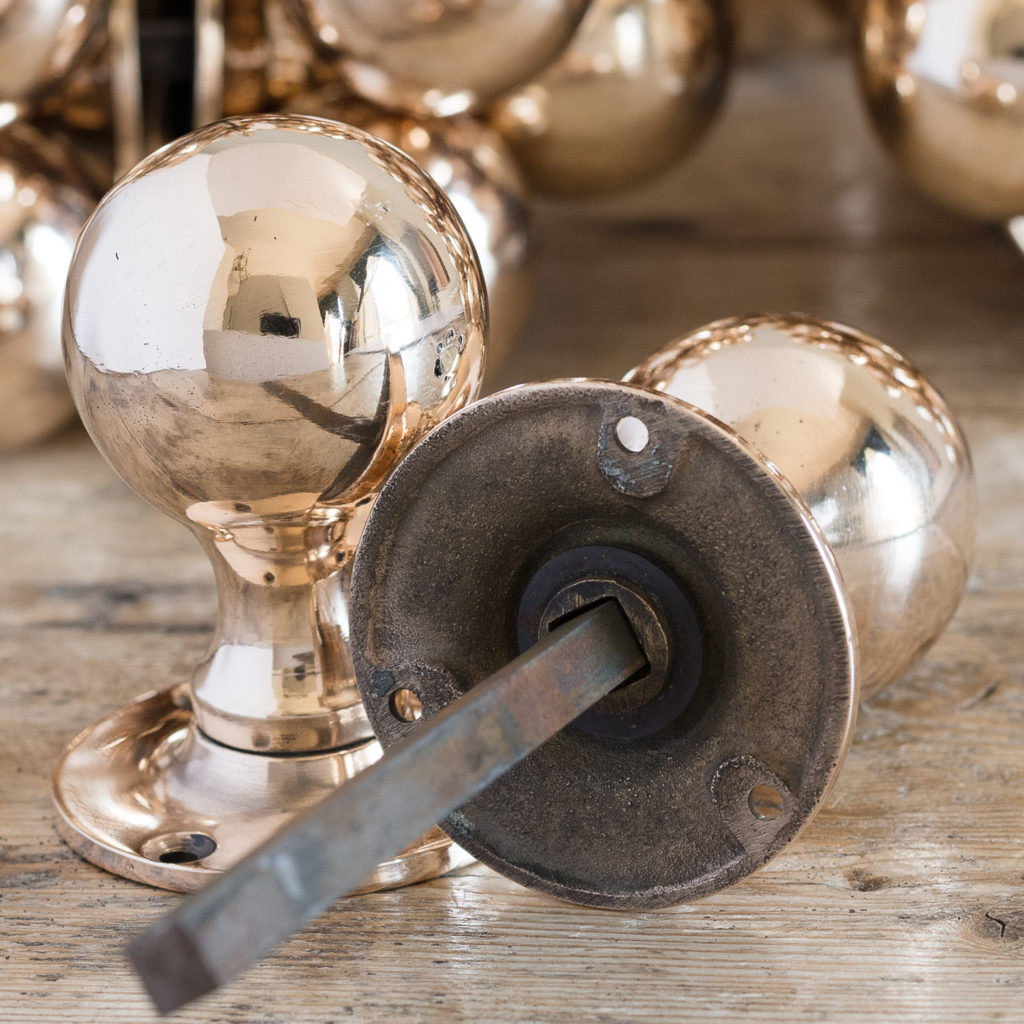 Long run of large antique bronze spherical door knobs,-127779