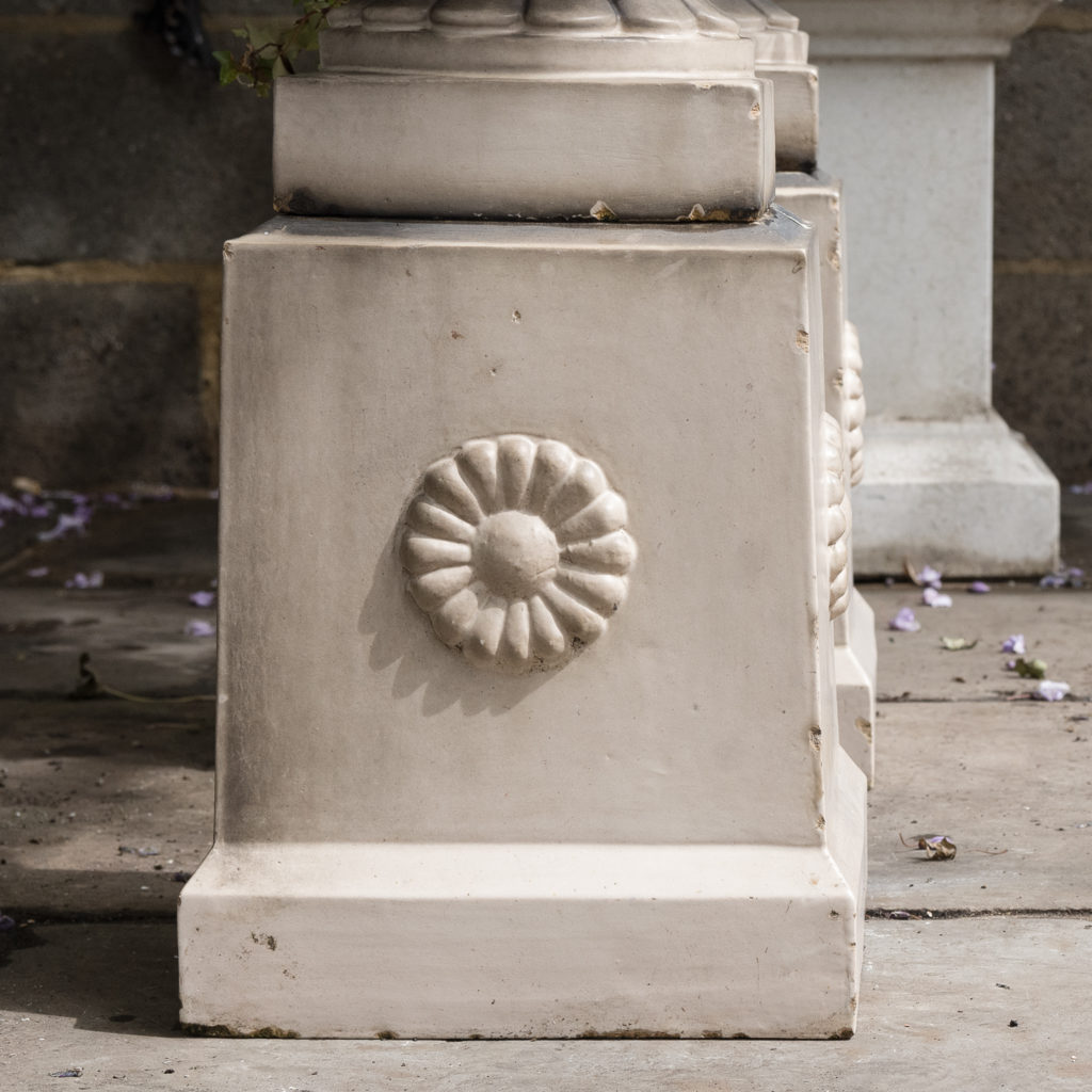 tapered pedestals with foliate motif to each side
