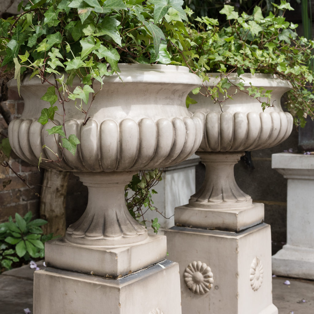 Pair of Victorian glazed terracotta tazza urns with pedestals,-127799