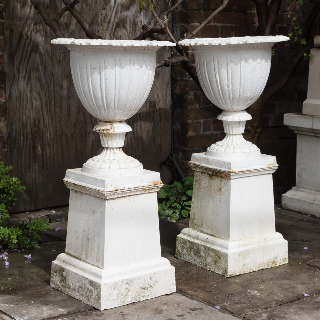 Pair of cast iron urns in the Classical Taste