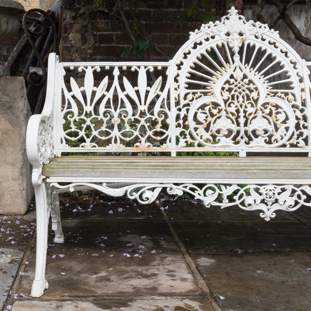 Cast iron garden bench painted white