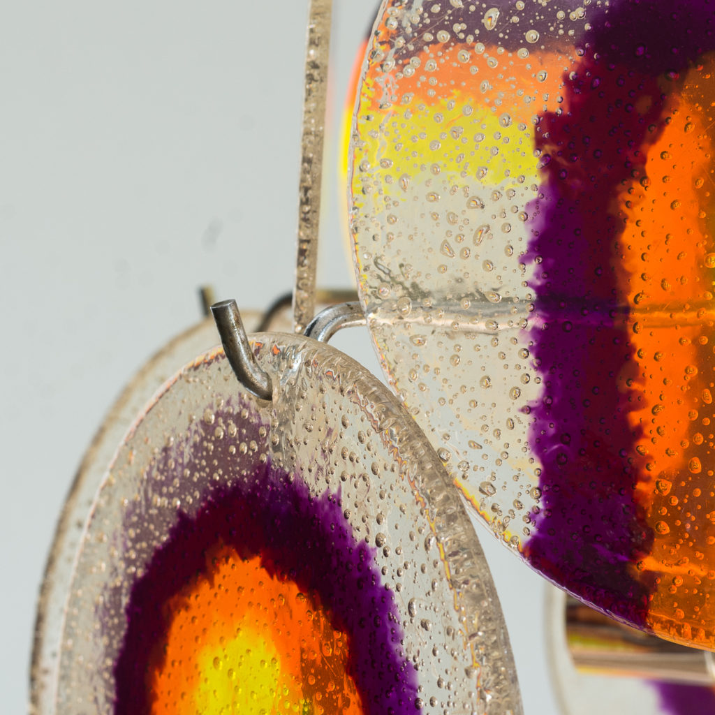 coloured acrylic discs suspended from chrome frame