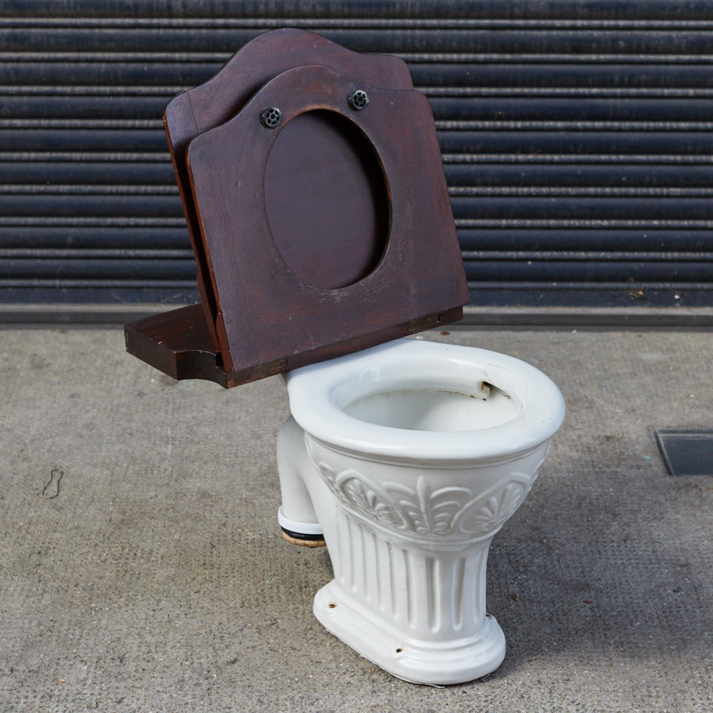 A hinged mahogany lavatory seat, -128349