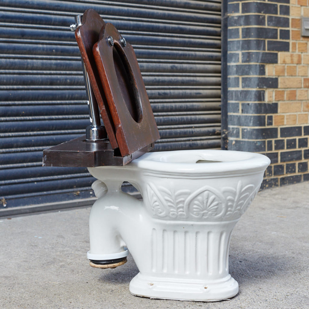 A hinged mahogany lavatory seat, -128350