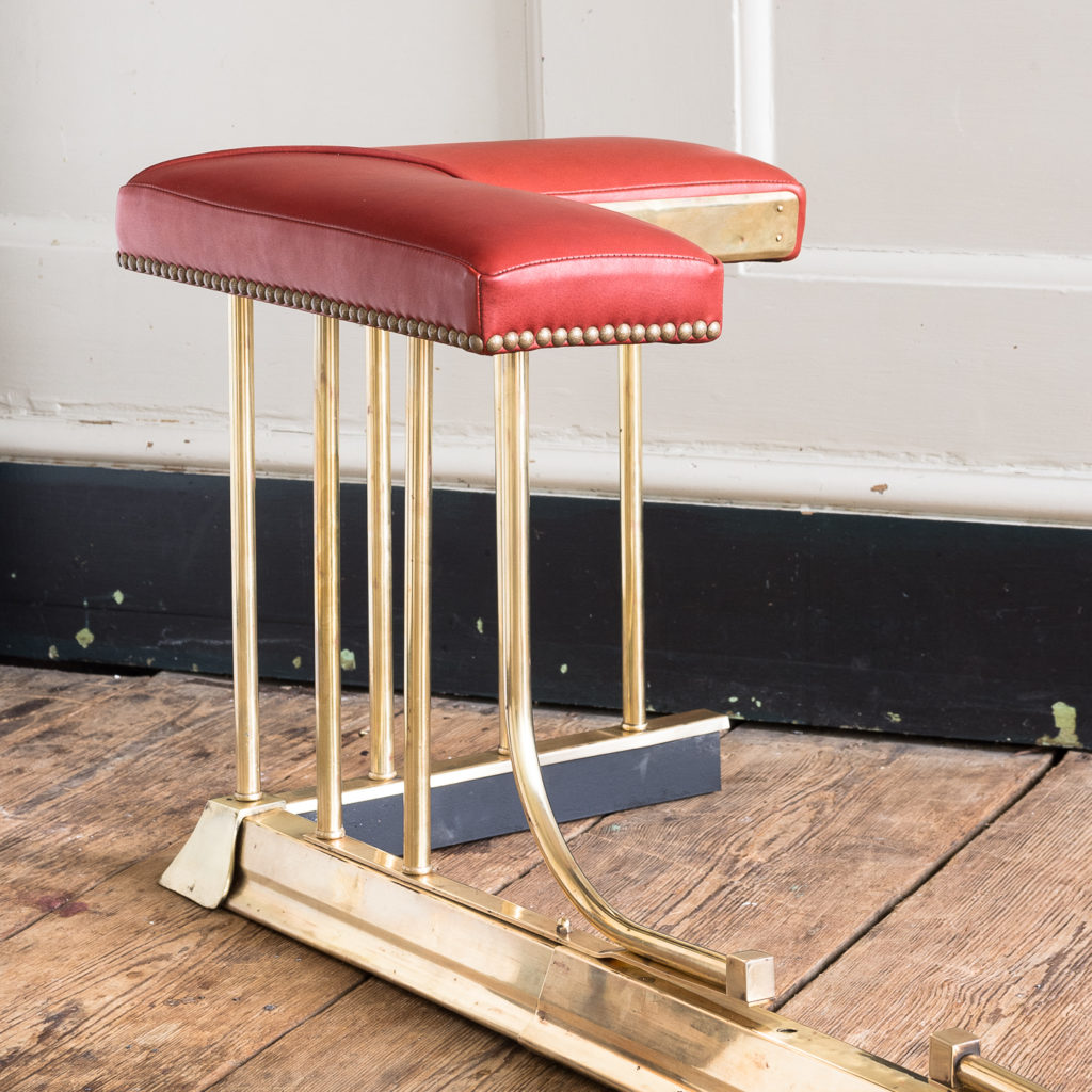 Twentieth century brass and leather upholstered club fender,-128130