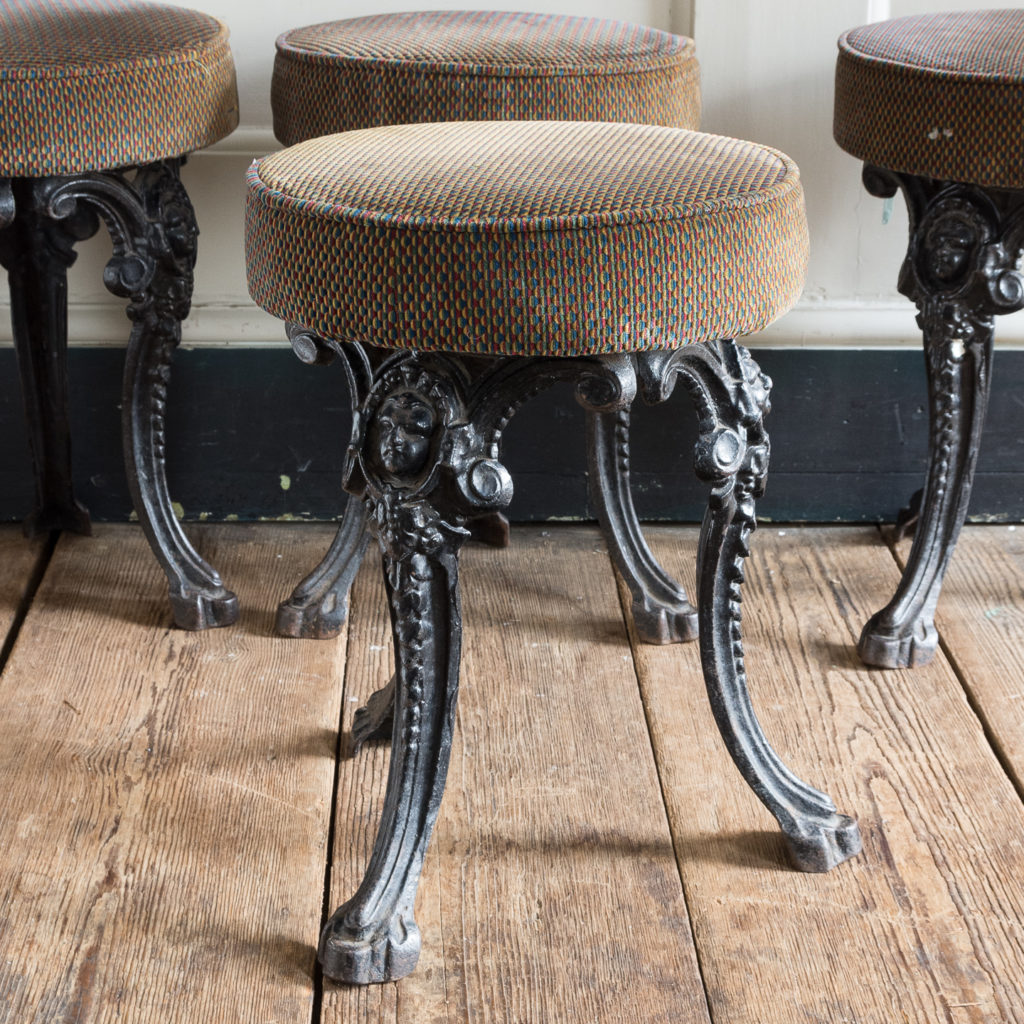 Cast iron pub stools,