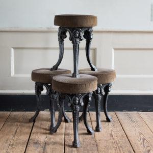 Cast iron pub stools,