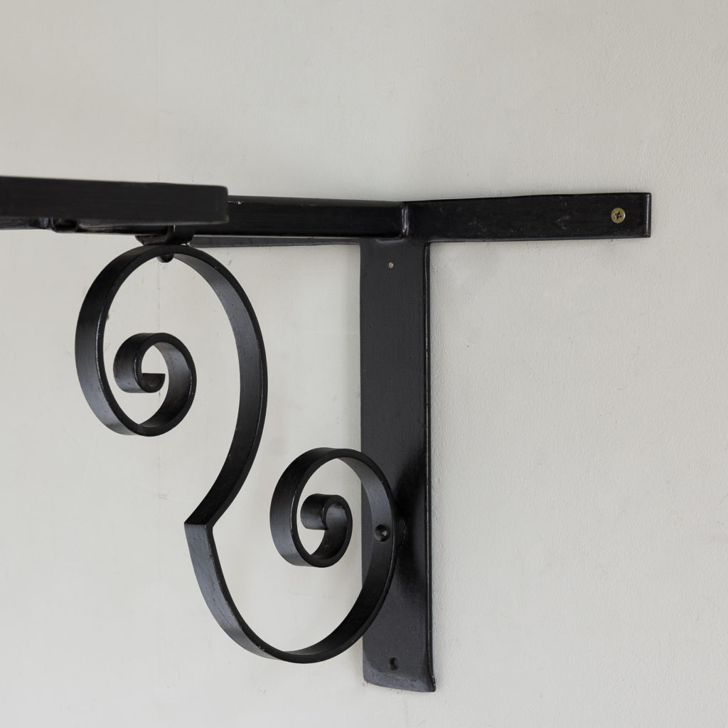 wrought iron bracket with scrolled support