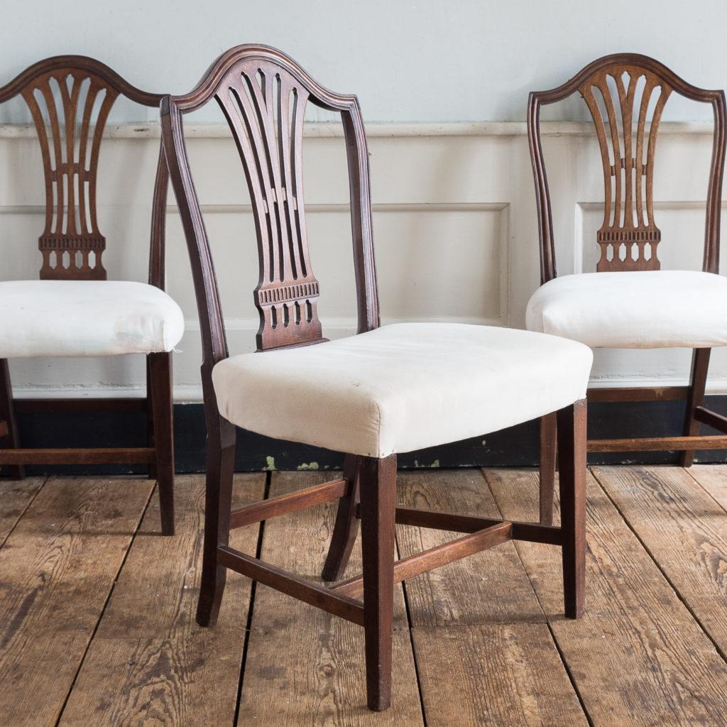 Three George III mahogany dining chairs,