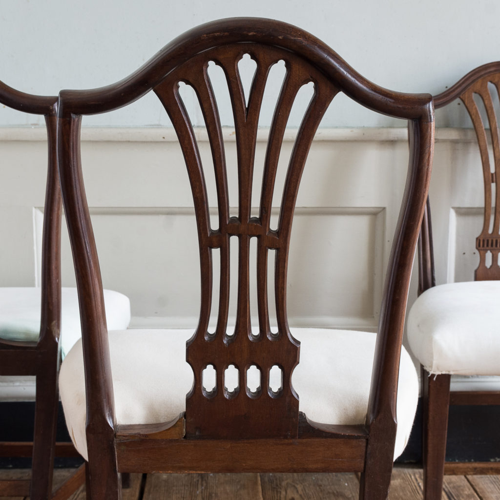 Three George III mahogany dining chairs,-128913