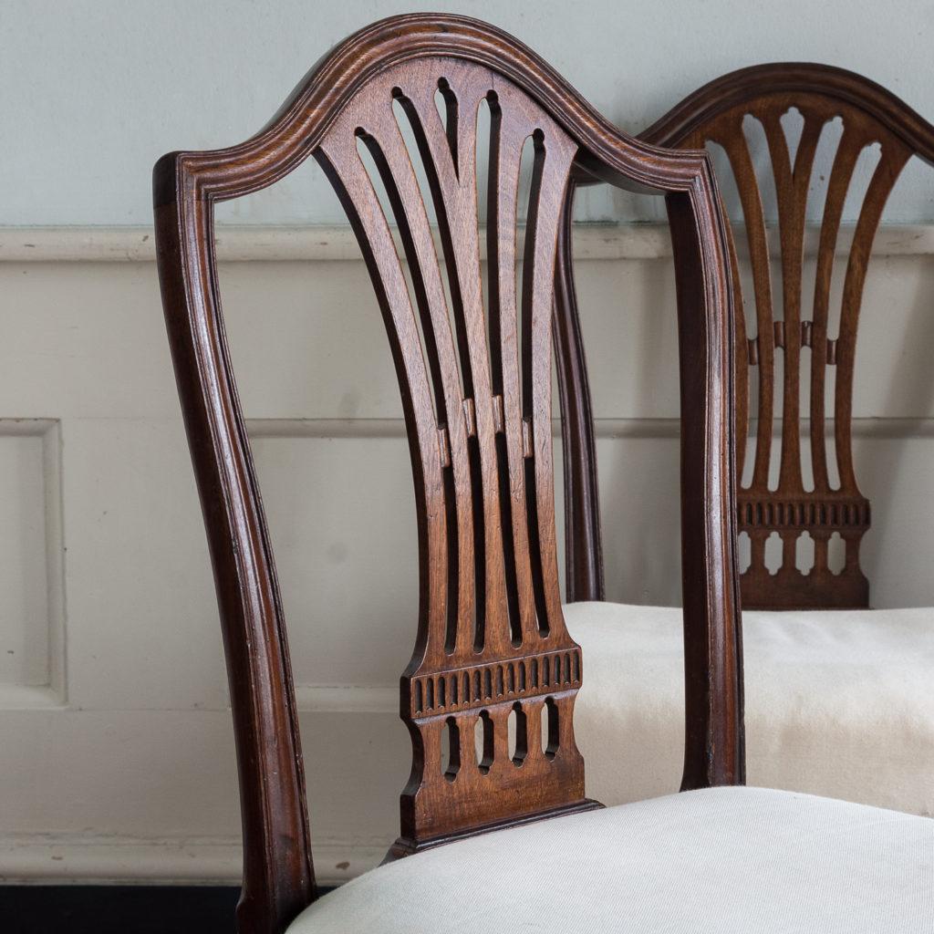 Three George III mahogany dining chairs,-128917