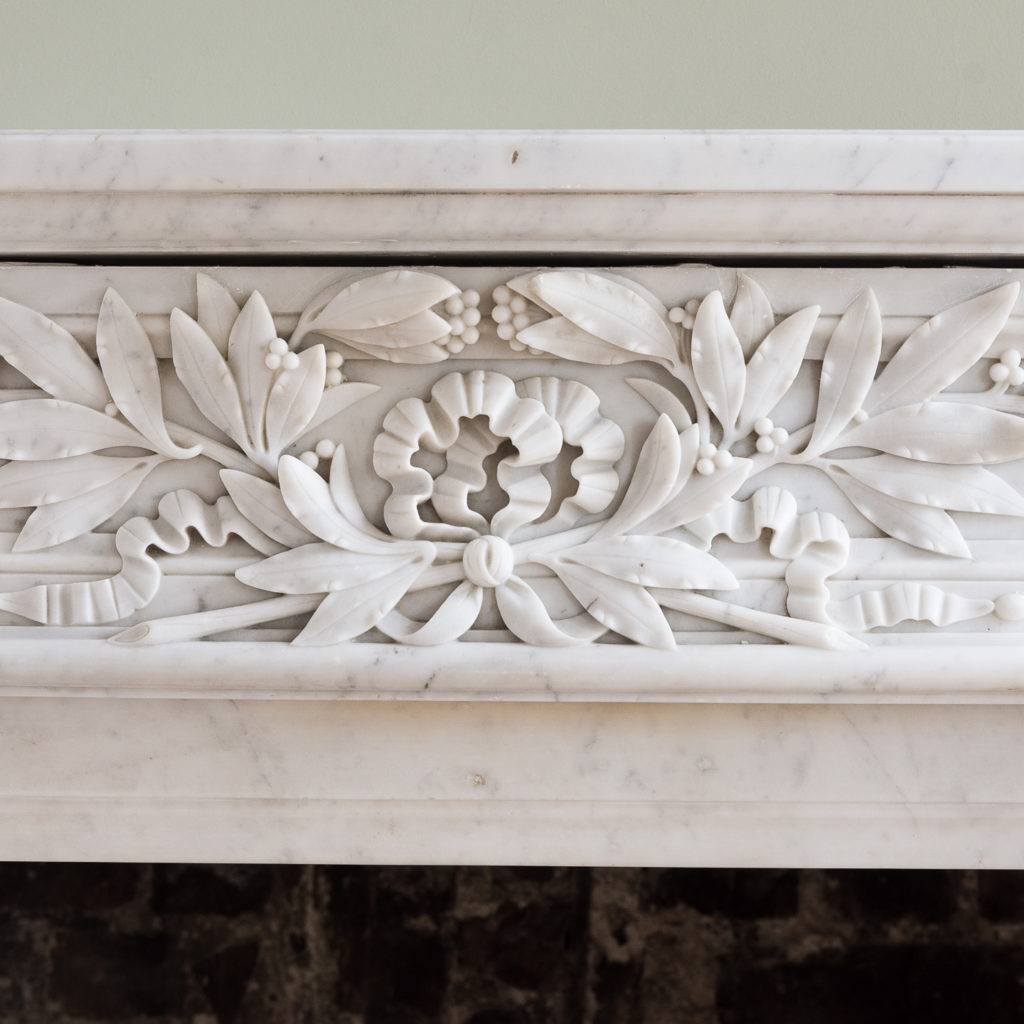finely carved frieze of laurel leaves and bowed ribbon