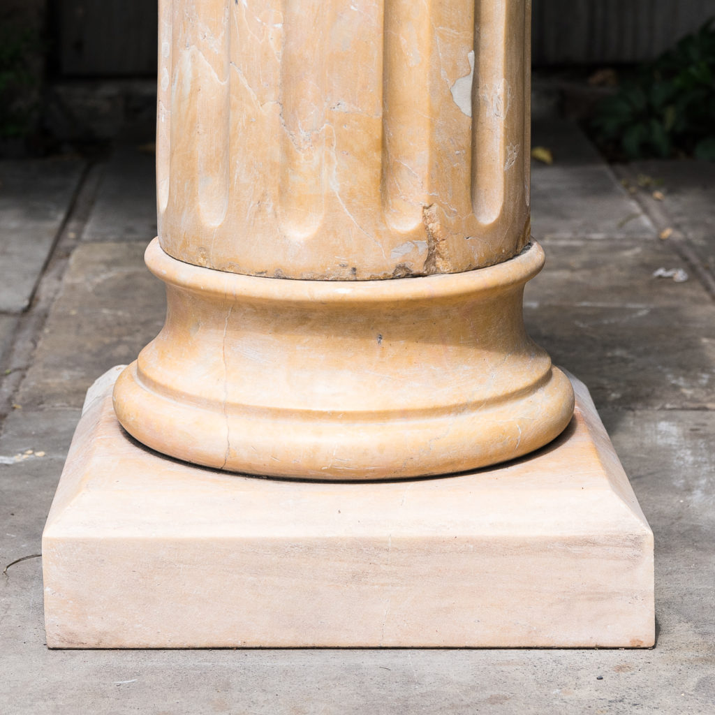 Four Valence yellow marble pedestals, -128955