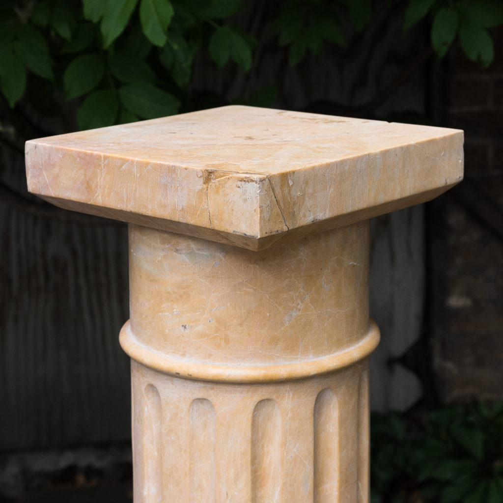 Four Valence yellow marble pedestals, -128948