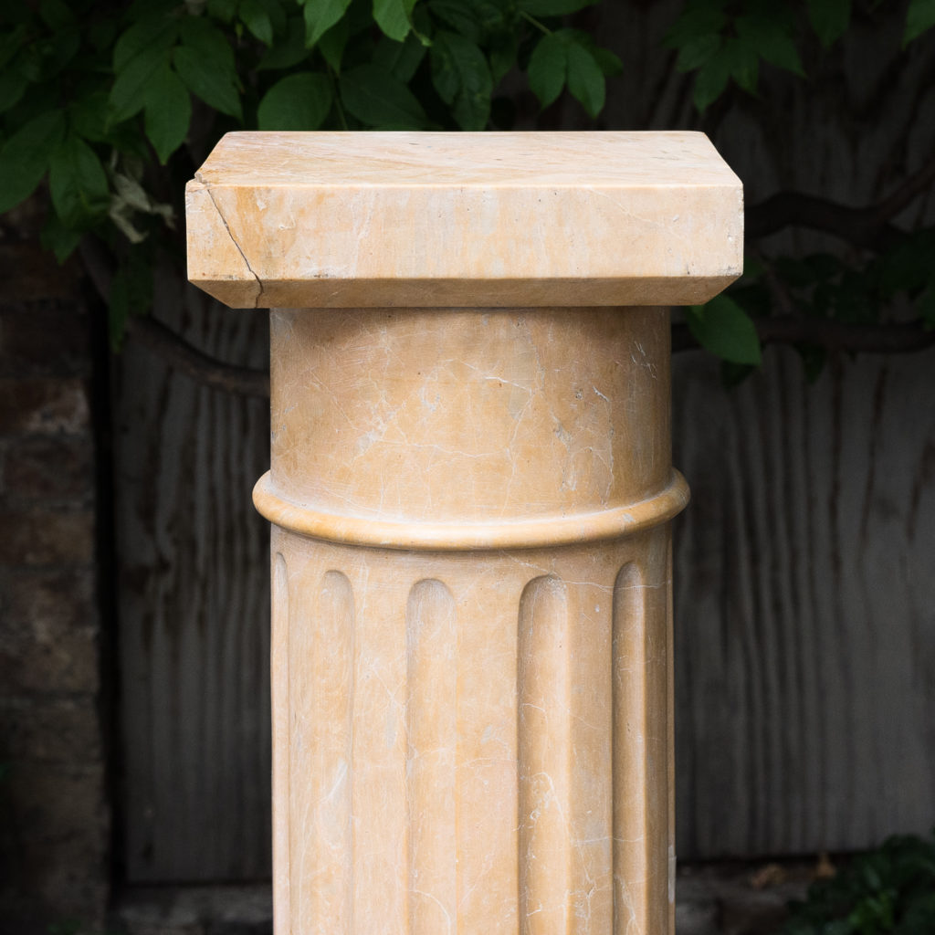 Four Valence yellow marble pedestals, -128949