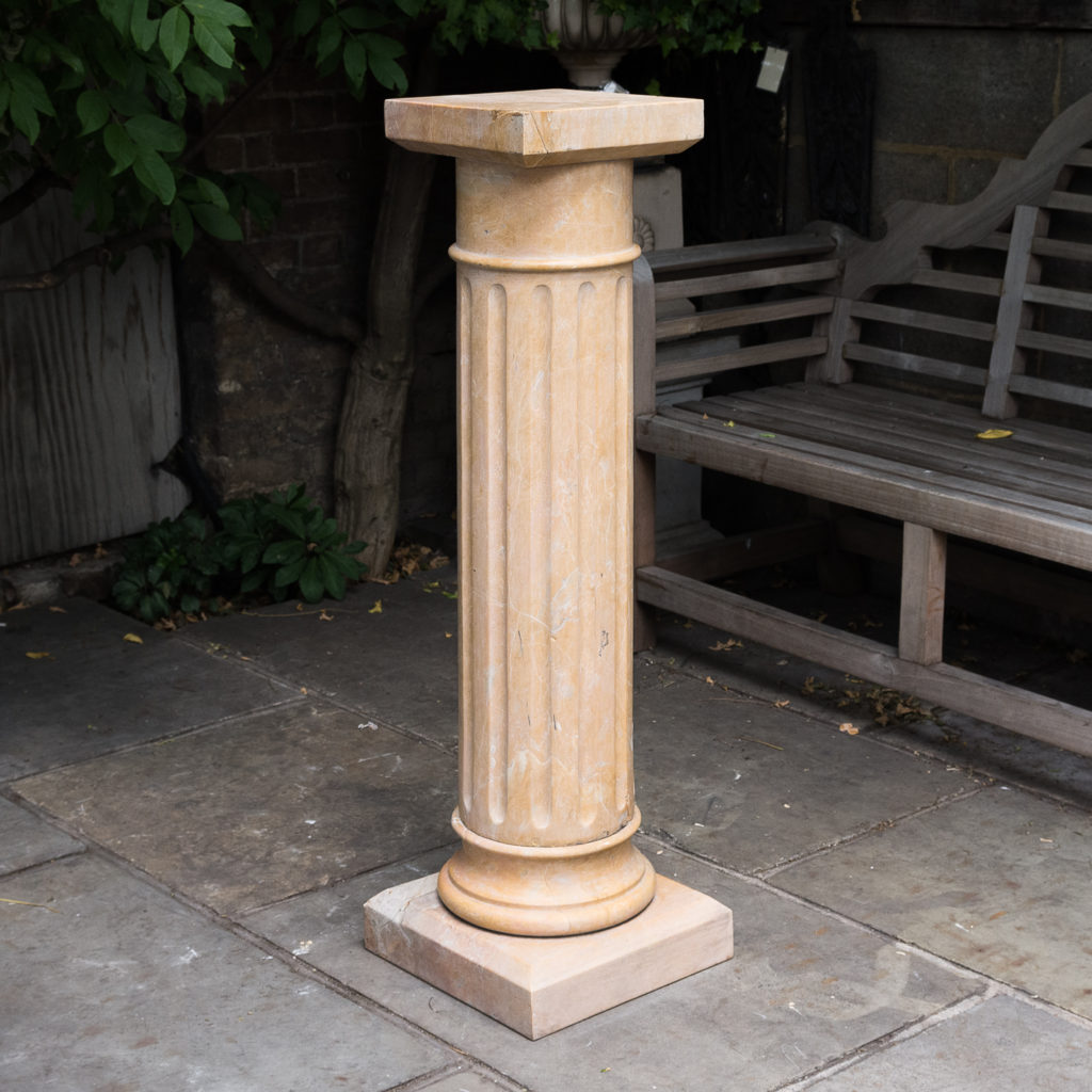Four Valence yellow marble pedestals, -0