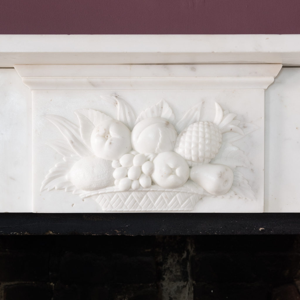 frieze with central tablet depicting a fruit bowl carved in relief