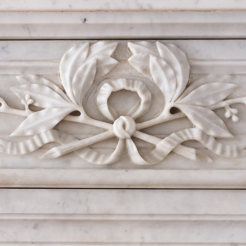 panelled frieze centred by laurel wreath