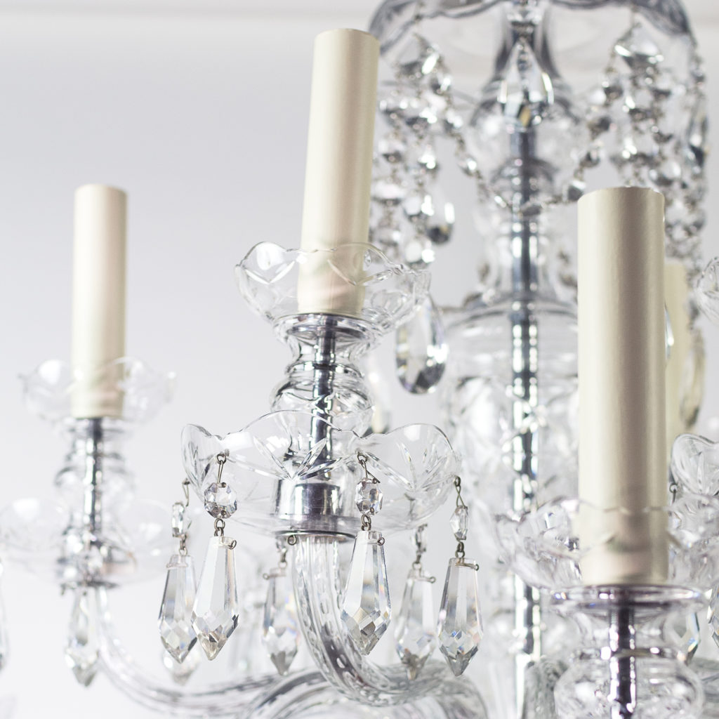 Two twentieth century cut and moulded glass twelve light chandeliers,-131575