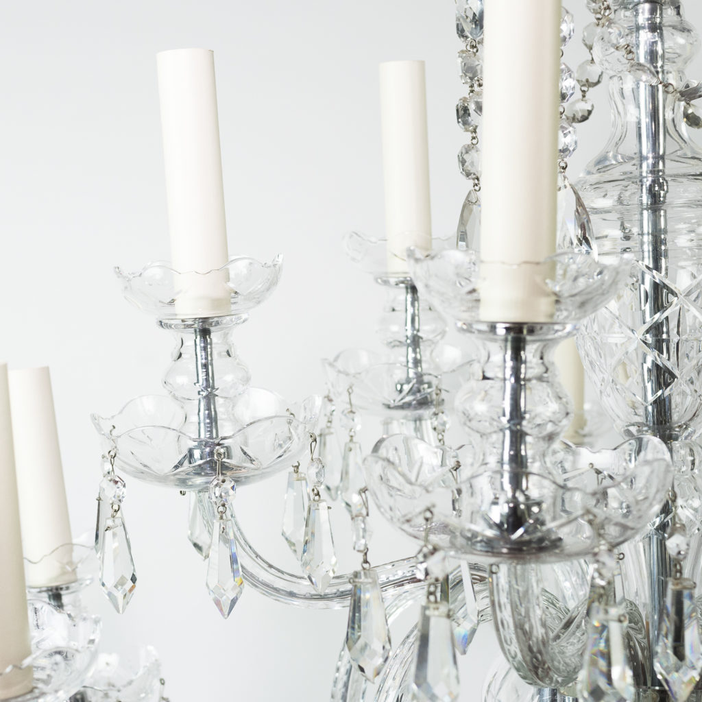 Two twentieth century cut and moulded glass twelve light chandeliers,-131574
