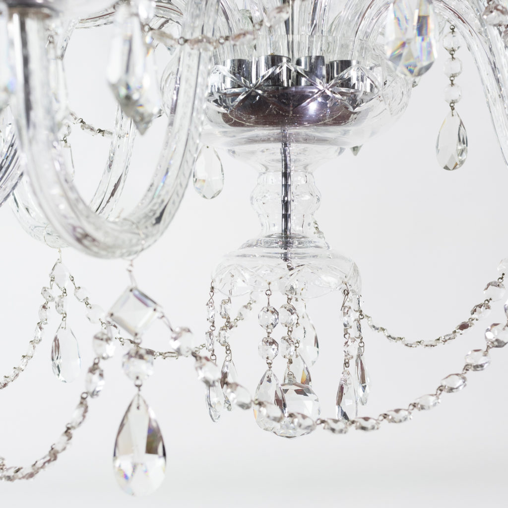 Two twentieth century cut and moulded glass twelve light chandeliers,-131579