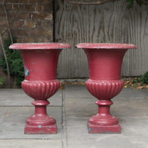 Pair of cast iron campana urns,