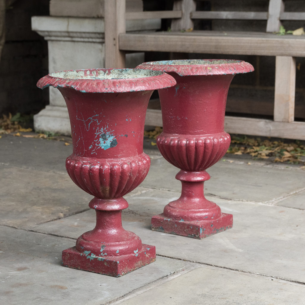 Pair of cast iron campana urns,