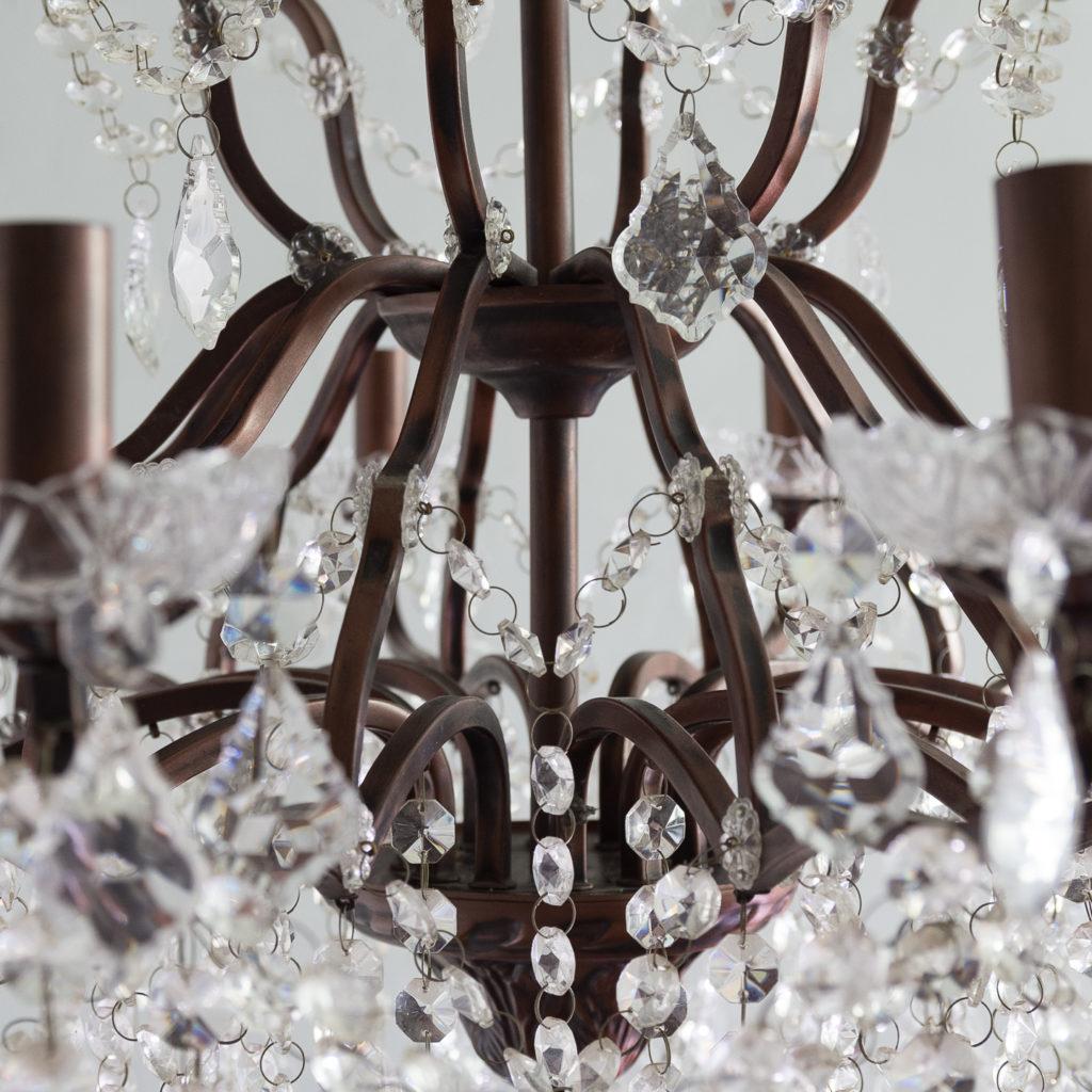 Twelve light glass lustre and bronzed metal chandeliers, -131594