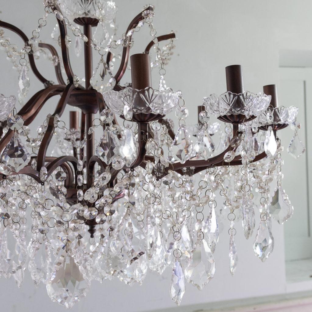 Twelve light glass lustre and bronzed metal chandeliers, -131596