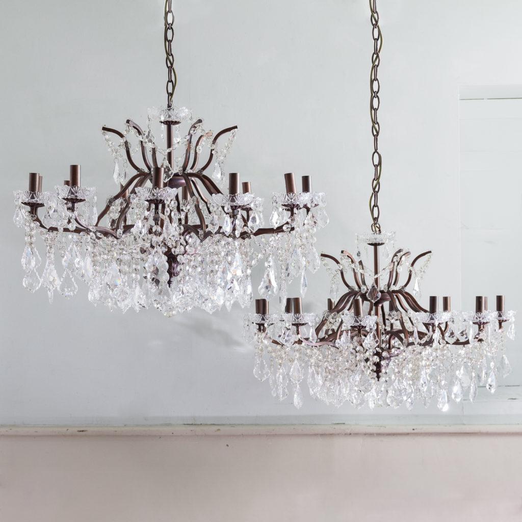 Twelve light glass lustre and bronzed metal chandeliers,