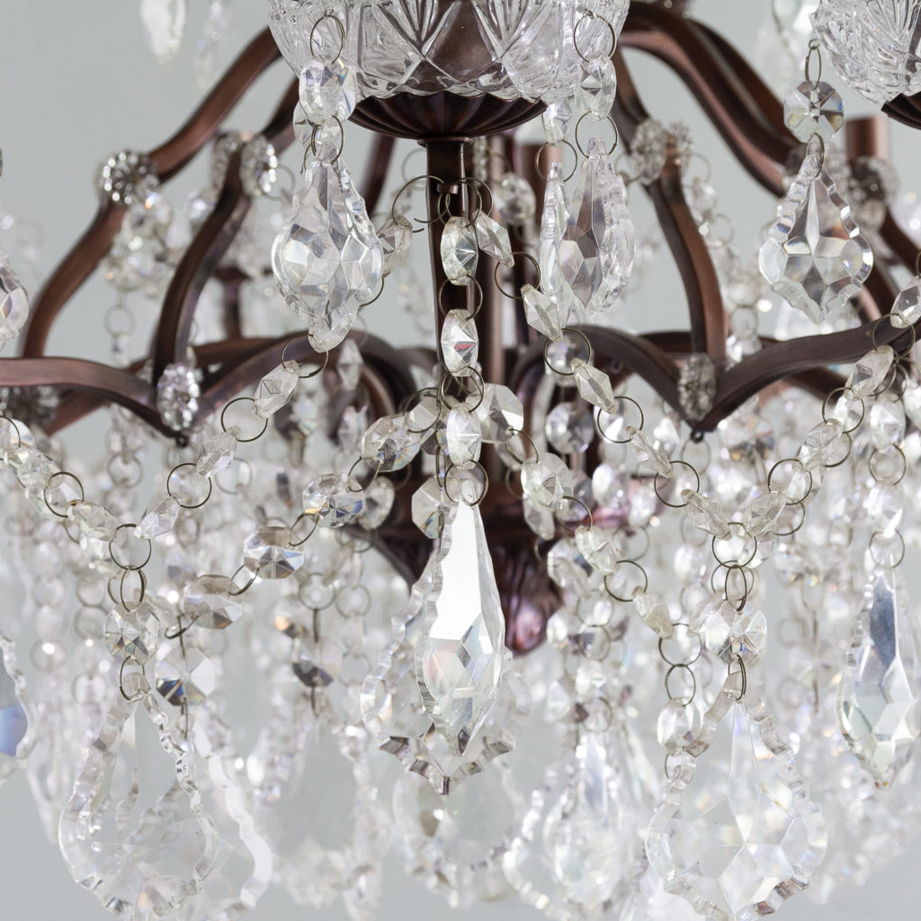 Twelve light glass lustre and bronzed metal chandeliers, -131589